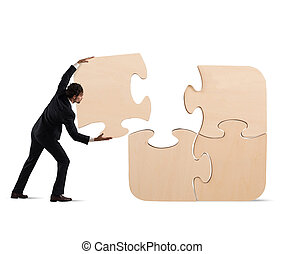 Complete a puzzle with missing piece - Businessman complete...