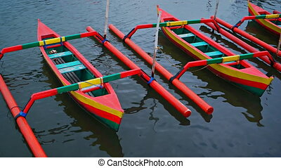 Small, Outrigger Canoes, Painted in Bold, Cheerful Colors -...