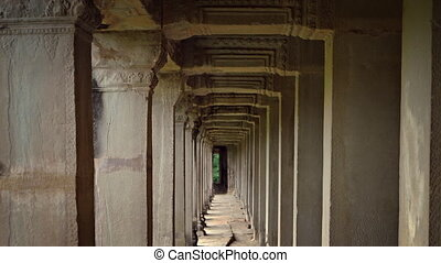 Perspective of Ancient Stone Columns at Angkor Wat in...