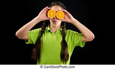Funny girl with sliced fruits on his eyes, stop motion...