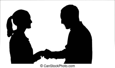 Silhouette People meet and shake hands. Close up. 076s. You...
