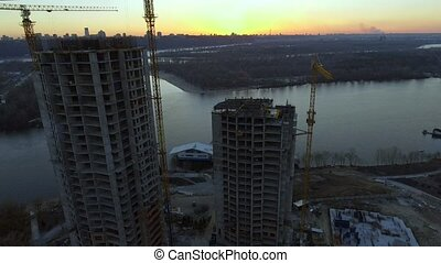 Construction site at sunset. Aerial shot