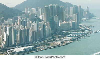 Crowded Coastal Cityscape with Complex Highway Traffic -...