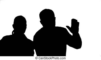 Silhouette Medical collegues celebrating, dancing and...