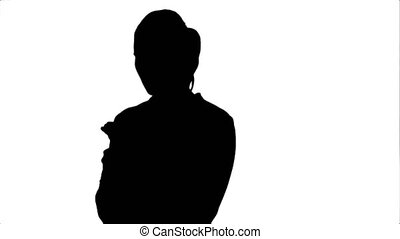 Silhouette Pensive business woman using mobile cell phone...
