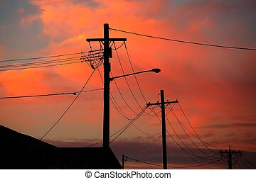 Electric line silhouettes - Electric lines against colorful...