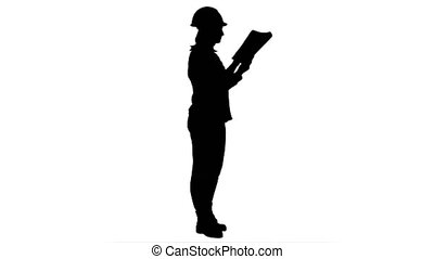 Silhouette Female engineer inspects construction site and...