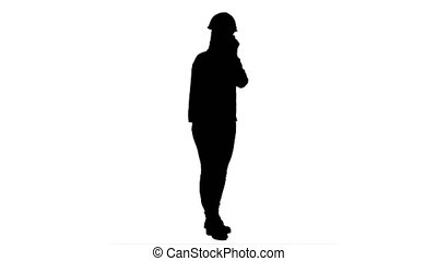 Silhouette Woman in orange hardhat calling the phone. 076s....