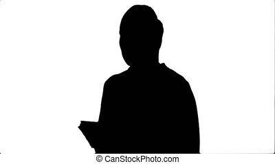 Silhouette Young business woman inventing ideas, writing...