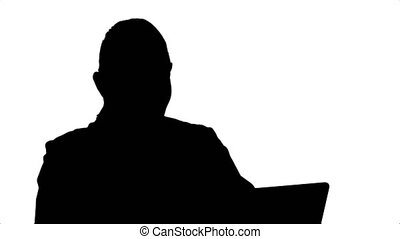 Silhouette Doctor giving consultation to patient online...