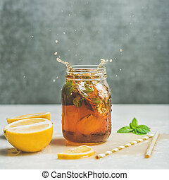 Summer Iced tea with lemon and herbs, square crop - Summer...
