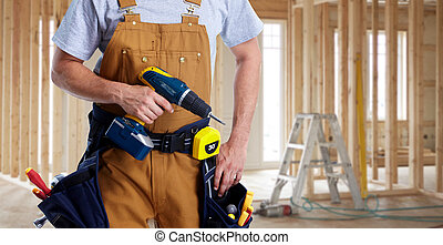 Construction worker with drill