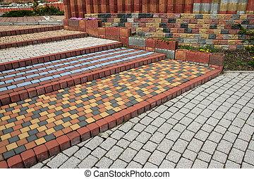 Cobblestone steps - Tiled, colorful, decorative pavement....