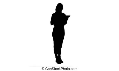Silhouette Concentrated young businesswoman using digital tablet present a project.