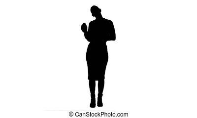 Silhouette Pretty female businesswoman describing and advertising pills for the camera.