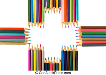 Variety of colored pencils arranged as a Plus sign, isolated...
