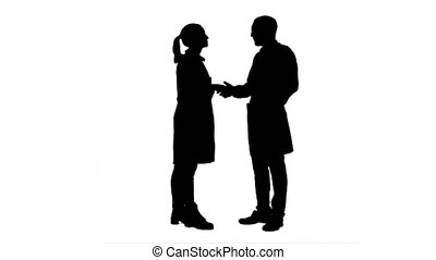 Silhouette Happy doctor and young nurse smiling, thanking...