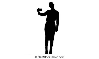 Silhouette Young pretty businesswoman take selfie with cell phone.
