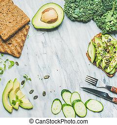 Avocado, cucumber, kale, kress sprouts, pumpkin seeds...
