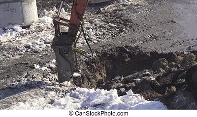 Breaker (hydraulic) cuts frozen soil Timelapse stock footage video