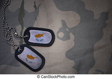 army blank, dog tag with flag of cyprus on the khaki texture...