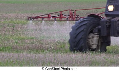 farm tractor spray field. - close up of farm tractor spray...