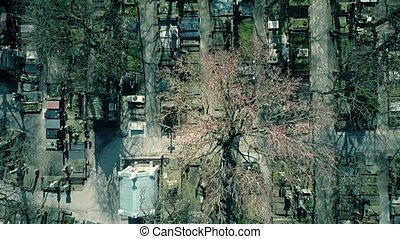 Aerial shot of old catholic cemetery on a sunny spring day,...