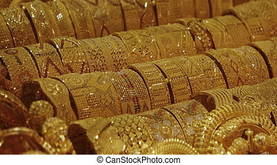 Intricately Patterned Gold Jewelry in a Dubai Market - Many...