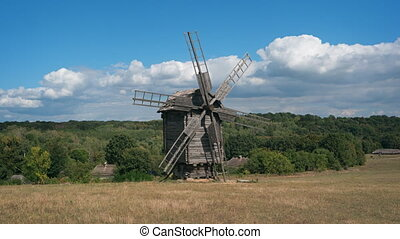 Timelapse Abstract of Tumbledown Wooden Windmill in...