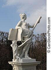 Woman statue in Vienna, Austria Winter parklands