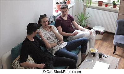Cool looking guys hanging out inside a house