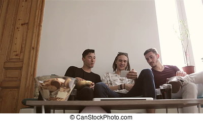 Group of three friends hanging out together and talking