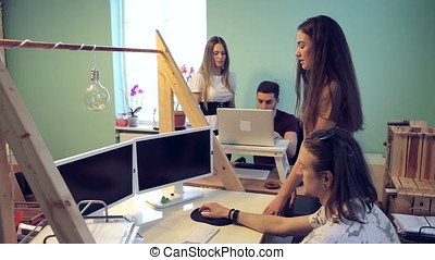 Group of young people working in office