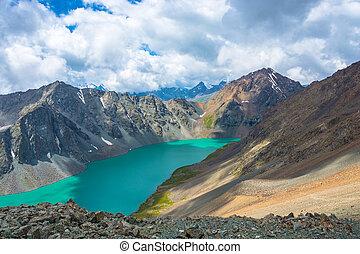 Landscape with mountain lake Ala-Kul, Kyrgyzstan. -...