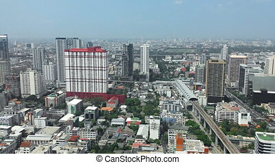 Crowded Cityscape of Bangkok with Tall Buildings - Highrise...