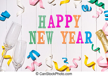 Happy New Year. Celebration Flat lay with colorful party items on wooden background.