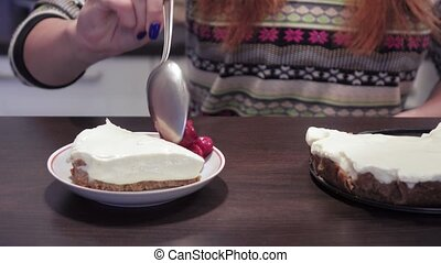 Girl adds cherries to cheese cake - To the cheese cake on...