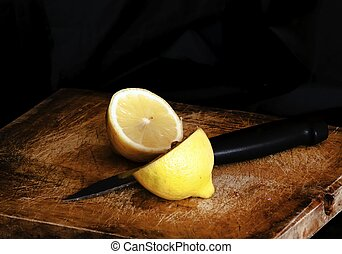 Lemon cut by a knife