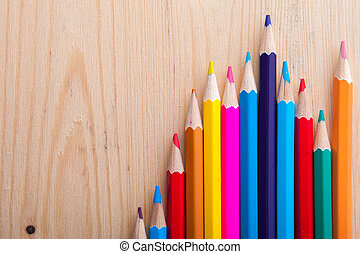 Group of multicolored bright pencils on table - Group of...