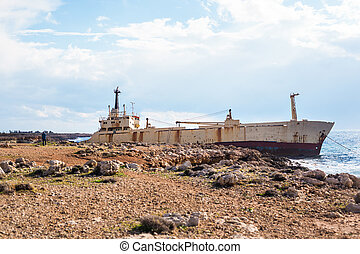 Abandoned ship on the rocks near the shore. Cyprus. -...