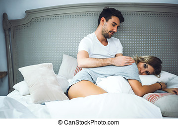 Beautiful couple enjoying time in bed