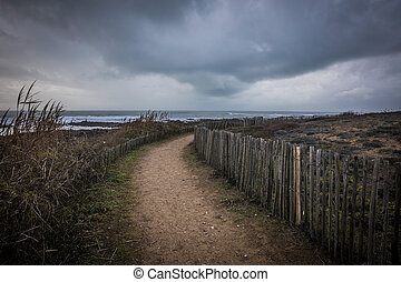 Path on the coast in bad and dark weather - Path on the...