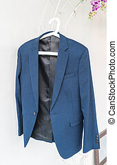 blue suit hanging