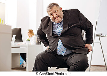 Unhealthy obese worker having trouble with a chair - My...