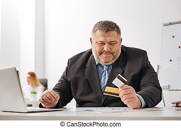 Joyful company worker getting his monthly payment