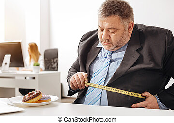 Chubby office worker having concerns about his weight - To...