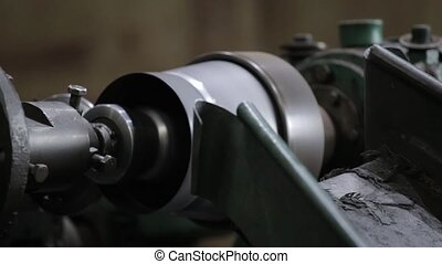 Bending Metal, piece of metal is bended by a machine. Metal...