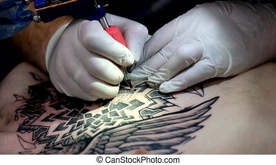 Artist making a tattoo for Tattoofest visitor - Moscow,...