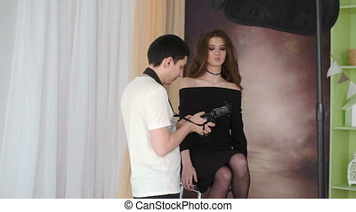 Photosession of beautiful model with long hair. Backstage.