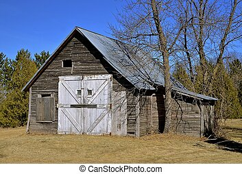 Old weathered garage and shed - An old weathered shed stands...